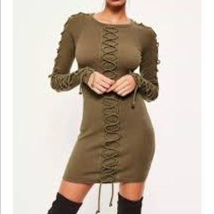 A khaki laced up detail ribbed bodycon dress